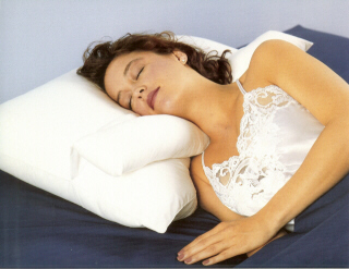 quitting sitting best sleeping posture never sleep on your stomach side back pillow between legs spoon pillow between arms woman towel under neck